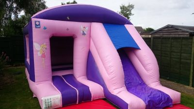 Pink front slide combo bouncy castle hire