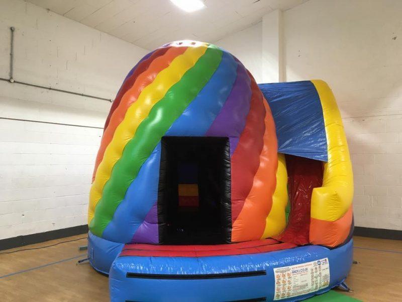 Small disco twist nad slide bouncy castle hire