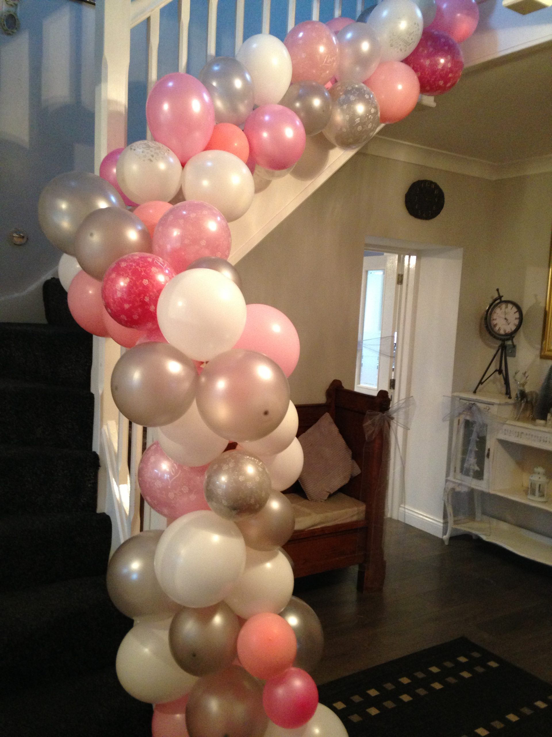 Party balloons up stairs